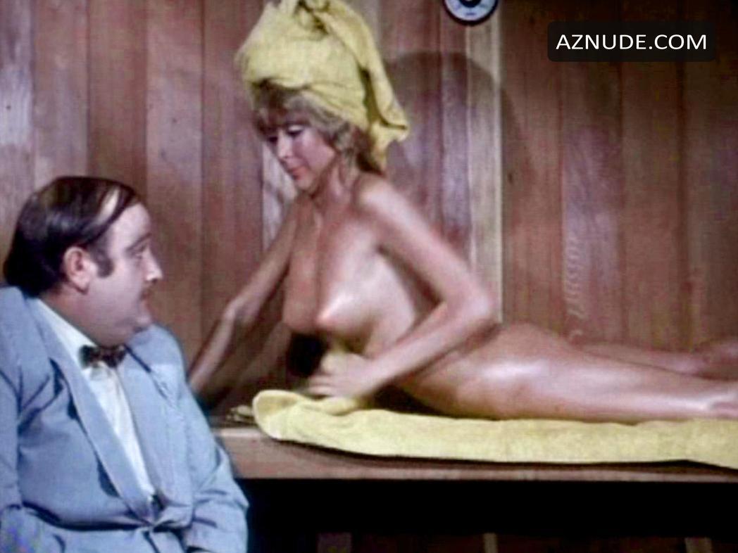 Kari laid on her bed naked